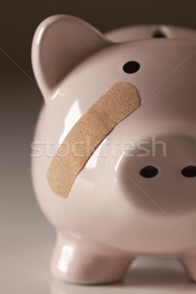 Tirelire bandage visage médecine Finance rose Photo stock © feverpitch