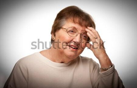 Senior vrouw hoofd witte geïsoleerd vrouwen Stockfoto © feverpitch