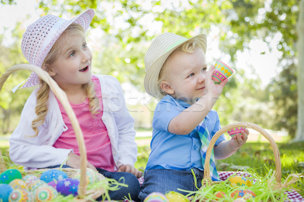 Cute Young Brother and Sister Enjoying Their Easter Eggs Outside Stock photo © feverpitch