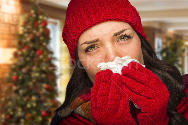 Sick Woman Blowing Her Nose With Tissue In Christmas Setting Stock photo © feverpitch