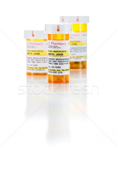 Three Non-Proprietary Medicine Prescription Bottle Isolated on W Stock photo © feverpitch