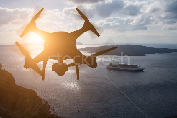 Unmanned Aircraft System (UAV) Quadcopter Drone In The Air At Su Stock photo © feverpitch