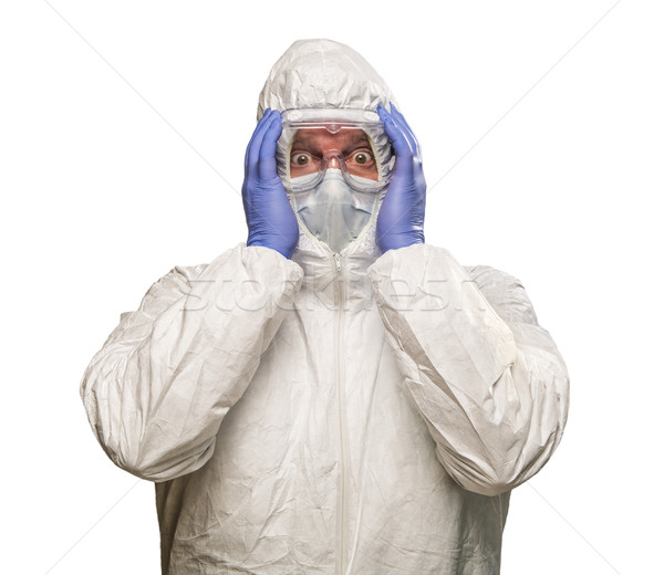 Man Holding Head With Hands Wearing HAZMAT Protective Clothing I Stock photo © feverpitch