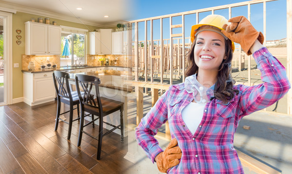 Female Construction Worker In Front of House Framing Gradating t Stock photo © feverpitch
