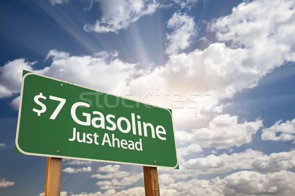 $7 Gasoline Green Road Sign and Clouds Stock photo © feverpitch