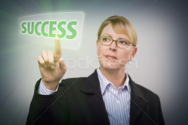 Donna spingendo successo pulsante interattivo touch screen Foto d'archivio © feverpitch