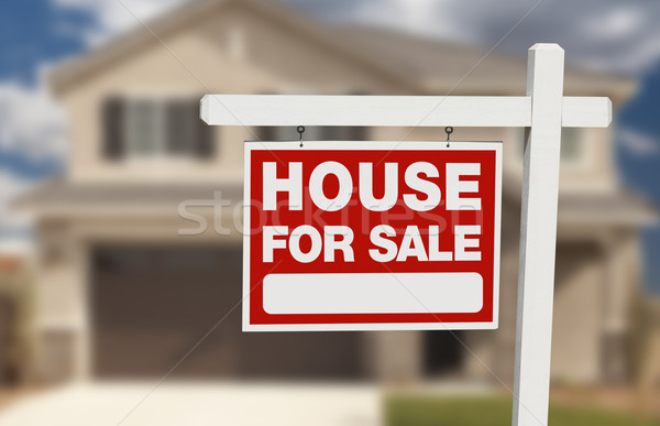 Stock photo: House For Sale Real Estate Sign and New Home