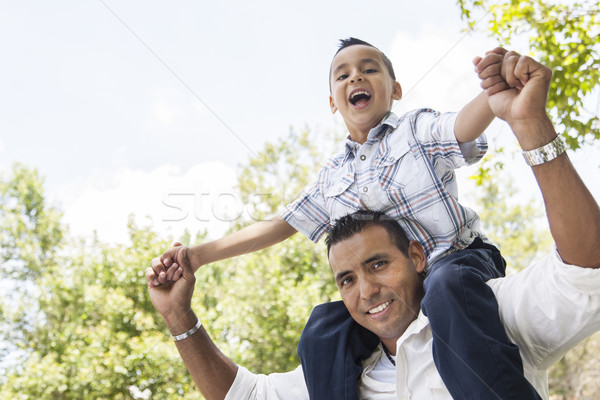 Hispanic Father and Son Having Fun in the Park Stock photo © feverpitch