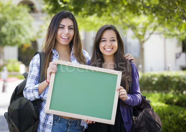 Mixed Race Female Students Holding Blank Chalkboard Stock photo © feverpitch