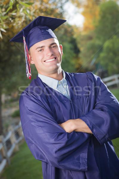 Yakışıklı erkek mezun kapak cüppe mutlu Stok fotoğraf © feverpitch