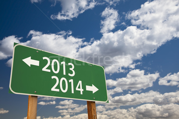 2013, 2014 Green Road Sign Over Clouds Stock photo © feverpitch