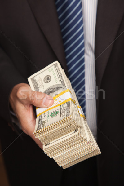 Businessman Handing Over Stack of Cash Stock photo © feverpitch
