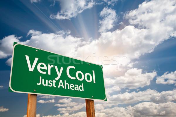 Cool groene verkeersbord wolken dramatisch zon Stockfoto © feverpitch