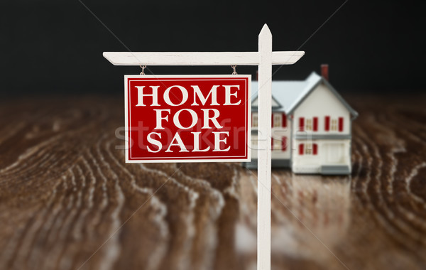 For Sale Real Estate Sign In Front of Model Home on Reflective W Stock photo © feverpitch