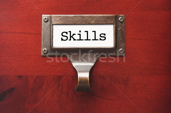 Lustrous Wooden Cabinet with Skills File Label Stock photo © feverpitch
