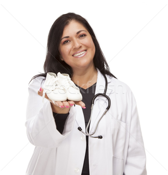 Hispanic Female Doctor or Nurse with Baby Shoes on White Stock photo © feverpitch