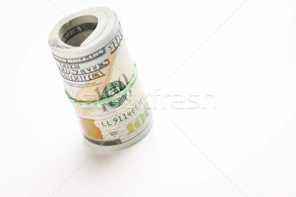 Abstract Roll of Newly Designed One Hundred Dollar Bills Stock photo © feverpitch