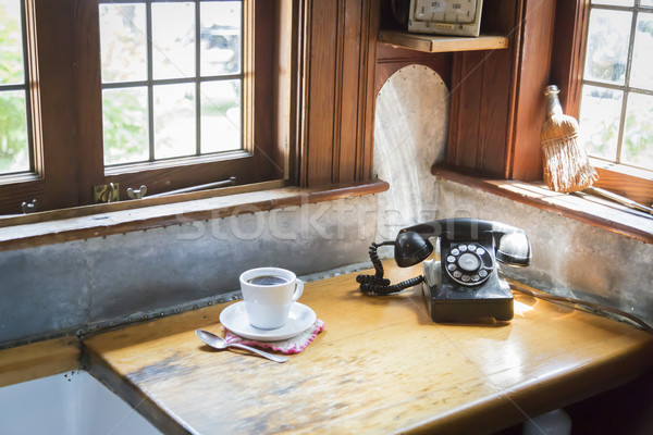 Antique Phone and Cup of Coffee in Old Kitchen Setting Stock photo © feverpitch