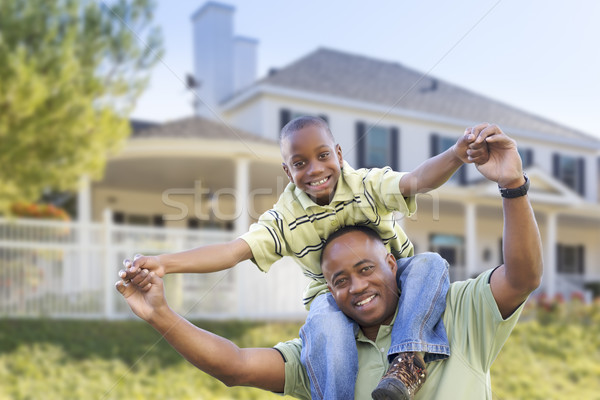 Playful African American Father and Son In Front of Home Stock photo © feverpitch