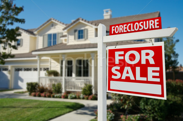 Foreclosure Real Estate Sign and House Stock photo © feverpitch