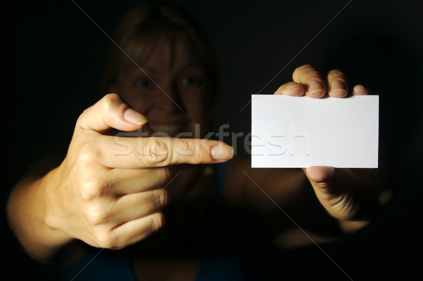 Woman Holding Blank Blank Business Card Stock photo © feverpitch
