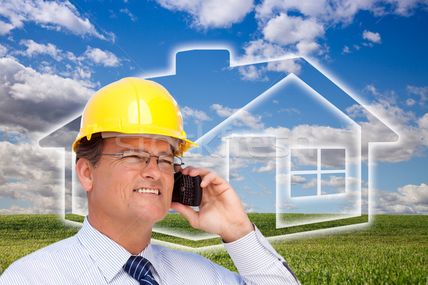 Contractor in Hardhat on Phone Over House, Grass and Clouds Stock photo © feverpitch