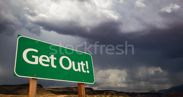Get Out Green Road Sign and Stormy Clouds Stock photo © feverpitch