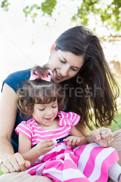 Mixed Race Young Mother and Cute Baby Girl Applying Fingernail P Stock photo © feverpitch