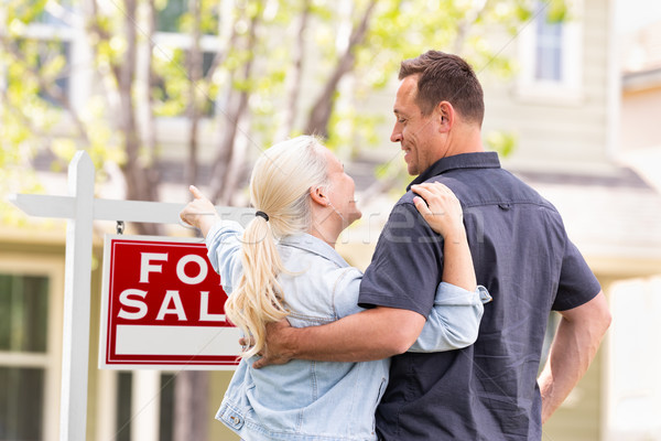 Caucasian Couple Facing and Pointing to Front of For Sale Real E Stock photo © feverpitch