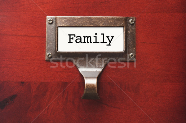 Lustrous Wooden Cabinet with Family File Label Stock photo © feverpitch
