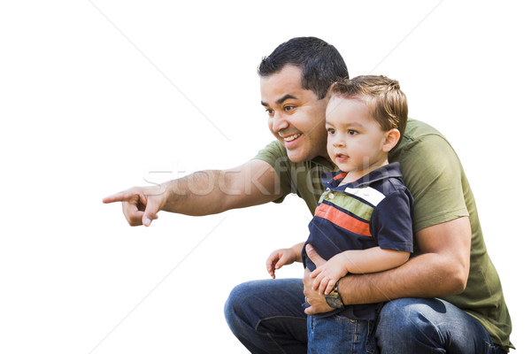 Hispanic Father Pointing With Mixed Race Son on White Stock photo © feverpitch