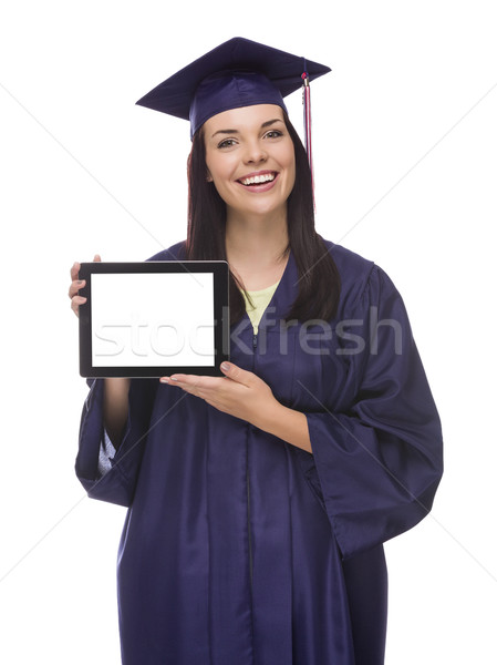 Female Graduate in Cap and Gown Holding Blank Computer Tablet Stock photo © feverpitch