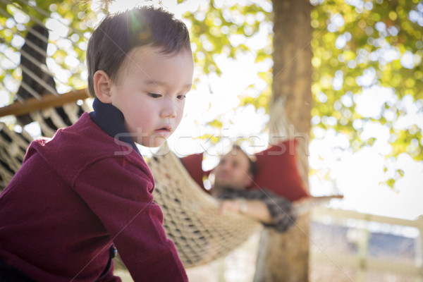 Mixed Race Boy Having Fun While Parent Watches From Behind Stock photo © feverpitch