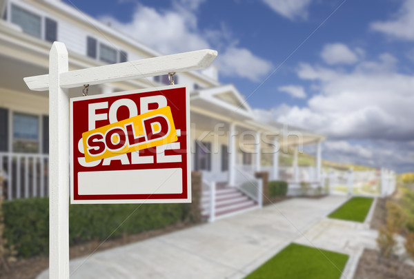 For Sale Sold Sign: Sold Home For Sale Real Estate Sign And House Stock Photo