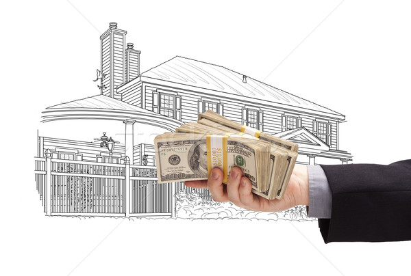 Hand Holding Thousands In Cash Over House Drawing Stock photo © feverpitch