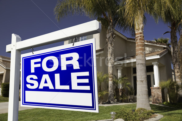 Stock photo: For Sale Real Estate Sign and House