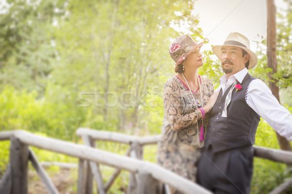 1920 romantische paar houten brug aantrekkelijk Stockfoto © feverpitch