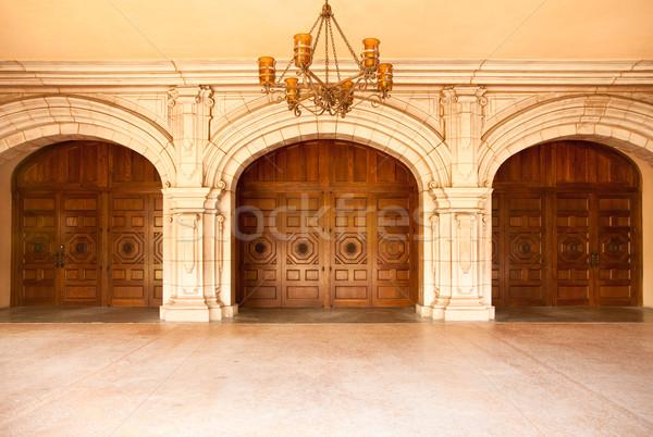 Fenséges klasszikus ajtók csillár három épület Stock fotó © feverpitch