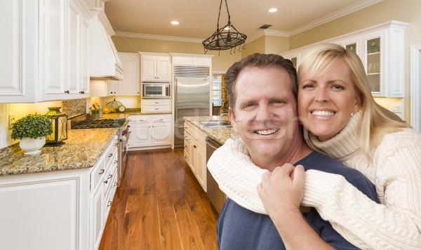 Happy Couple Inside Beautiful Custom Kitchen Stock photo © feverpitch