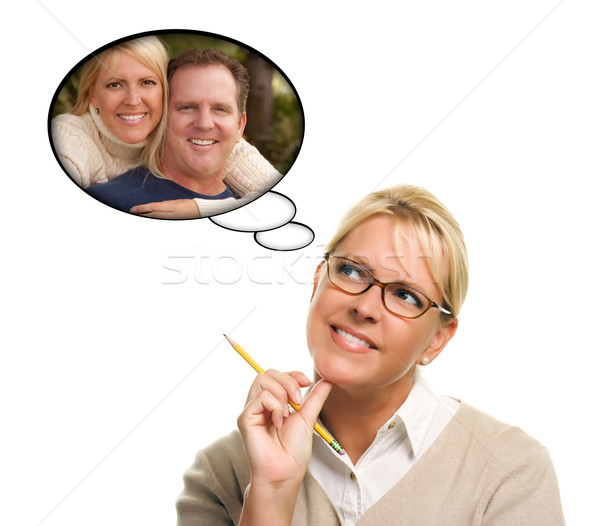 Beautiful Woman with Thought Bubbles of Herself and A Guy Stock photo © feverpitch