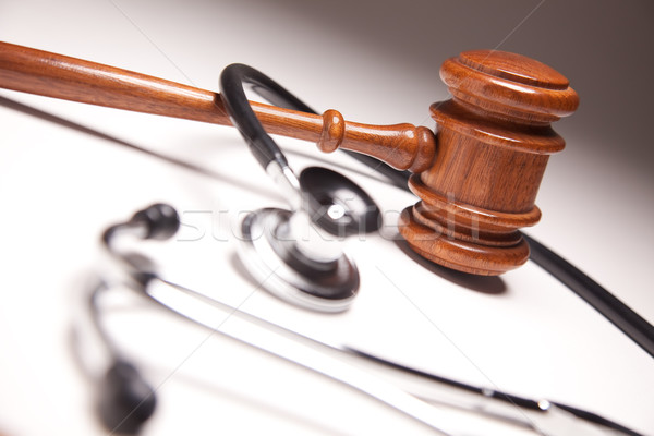 Gavel and Stethoscope on Gradated Background Stock photo © feverpitch