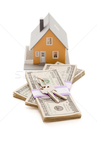 Home and House Keys on Stack of Money Isolated Stock photo © feverpitch