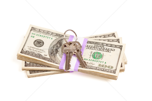 House Keys on Stack of Money Isolated Stock photo © feverpitch