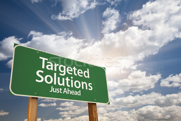 Targeted Solutions Green Road Sign Over Clouds Stock photo © feverpitch