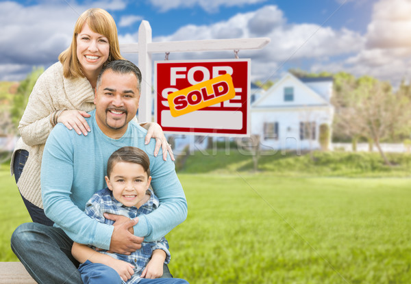 Mixed Race Family In Front of House and Sold For Sale Real Estat Stock photo © feverpitch