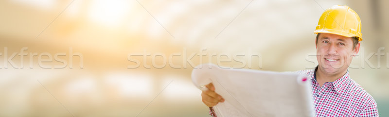 Handsome Adult Male Contractor Holding Constructions Plans with  Stock photo © feverpitch