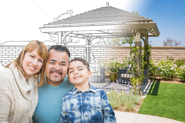 Mixed Race Family In Front of Drawing Gradating Into Photo of Fi Stock photo © feverpitch