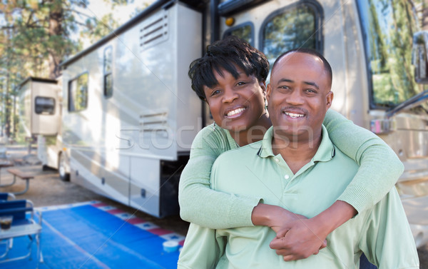 Happy African American Couple In Front of Their Beautiful RV At  Stock photo © feverpitch