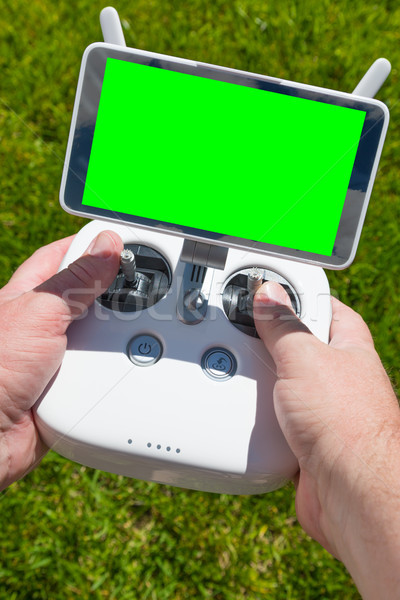 Hands Holding Drone Quadcopter Controller With Blank Green Scree Stock photo © feverpitch