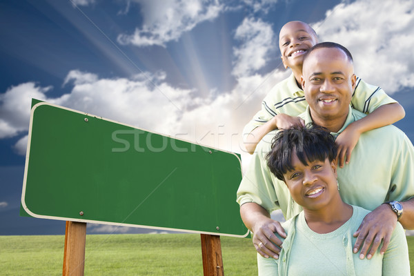 African American Family in Front of Blank Green Road Sign Stock photo © feverpitch